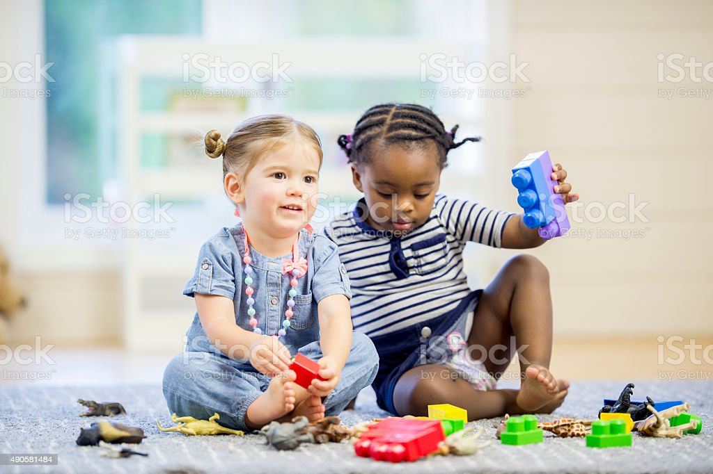 Children with Blocks and Plastic Animals stock photo