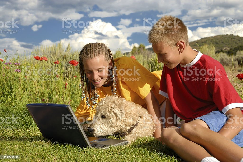 Children with dog at computer royalty-free stock photo