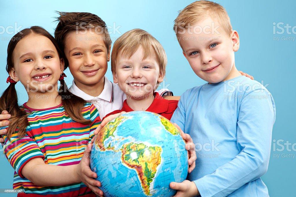 Children with globe stock photo