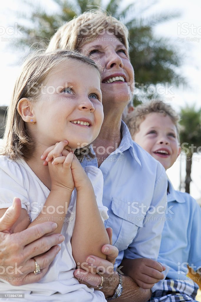 Children with grandmother stock photo