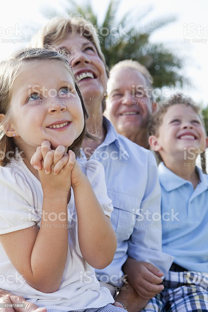 Children with grandparents outdoors stock photo