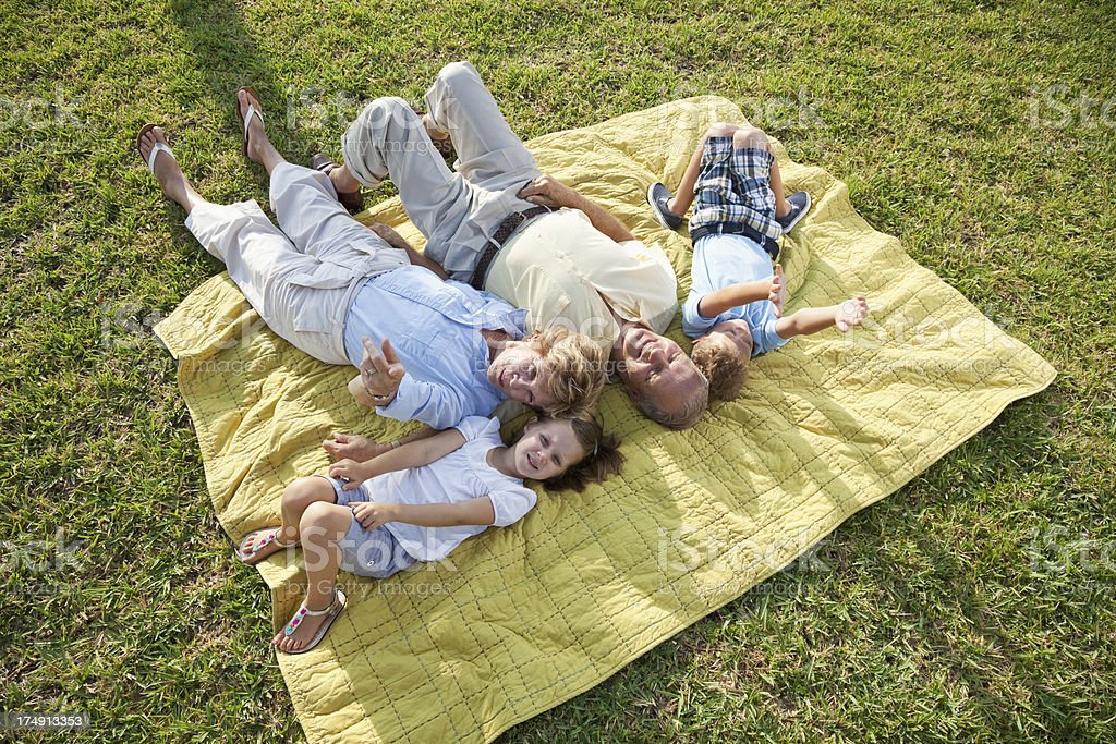Children with grandparents playing outdoors royalty-free stock photo