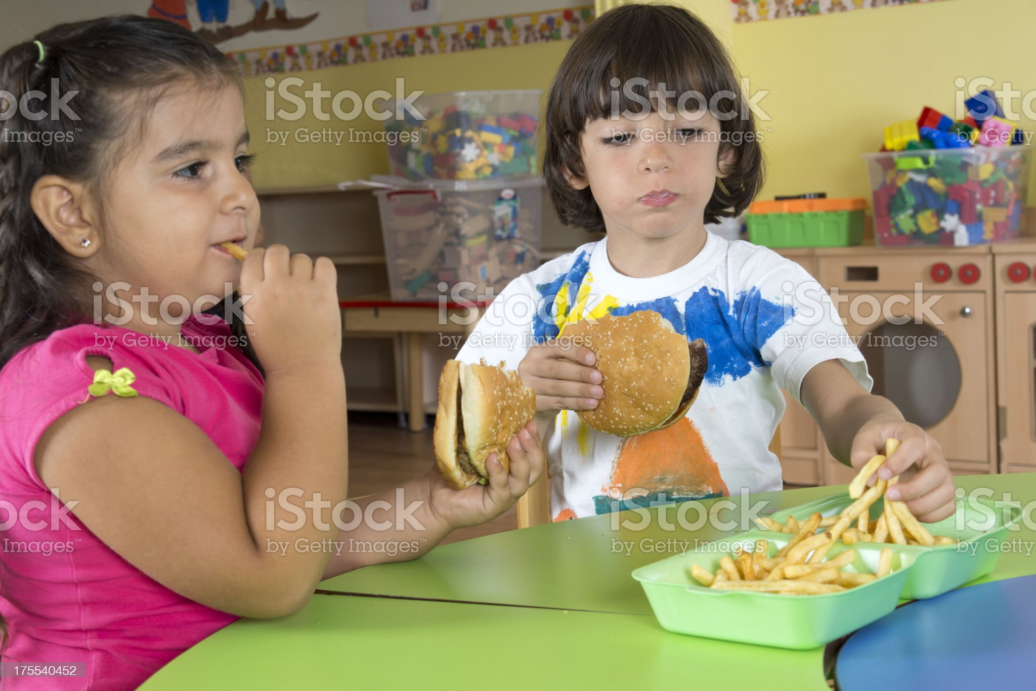 Children With Hamburgers And French Fries royalty-free stock photo