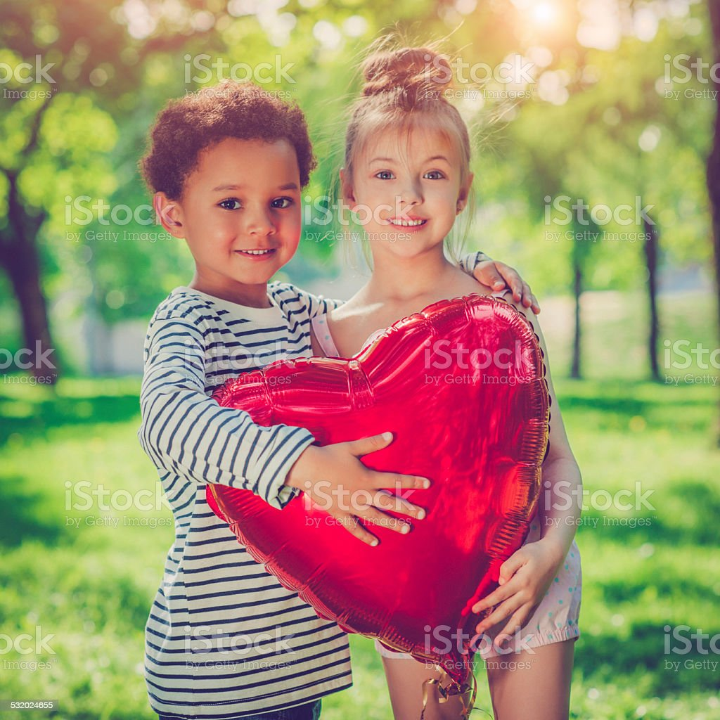 Children with heart stock photo