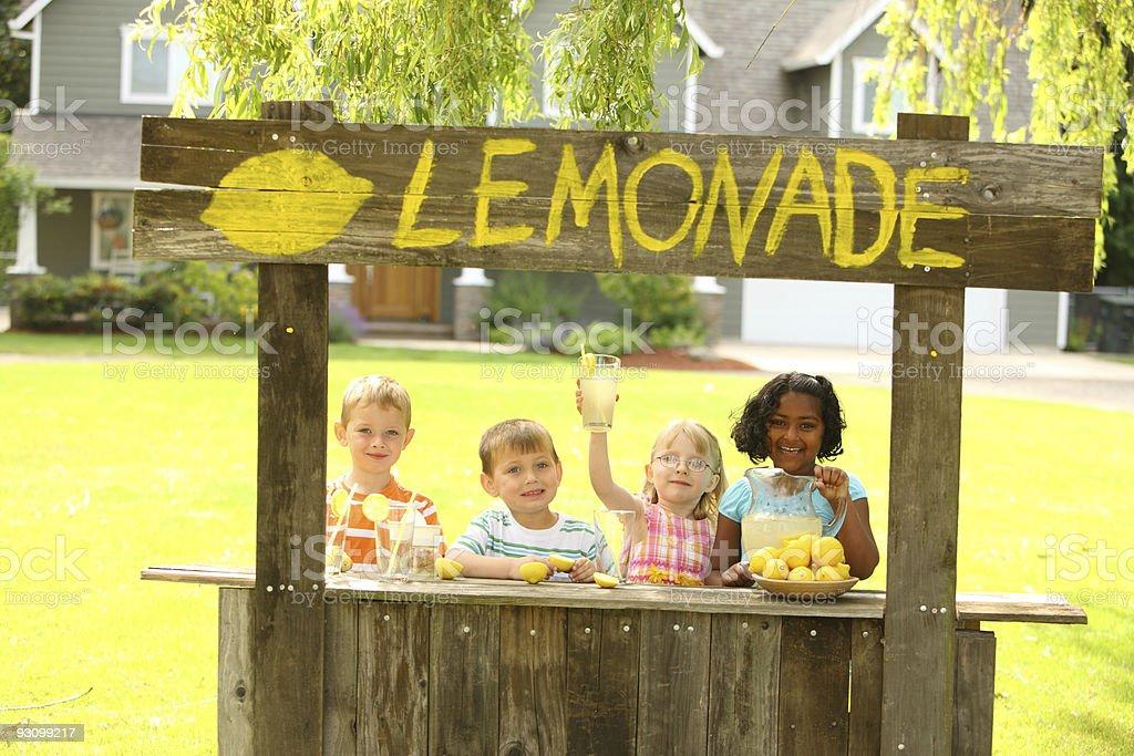 Children with lemonade stand stock photo