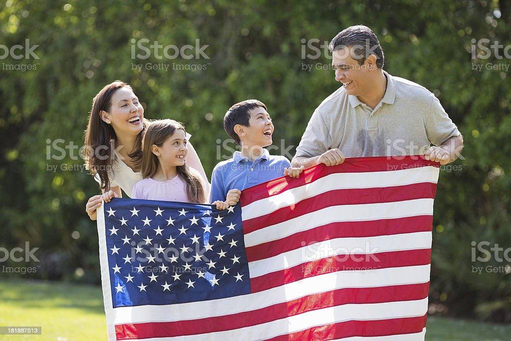 Children With Parents Holding American Flag royalty-free stock photo