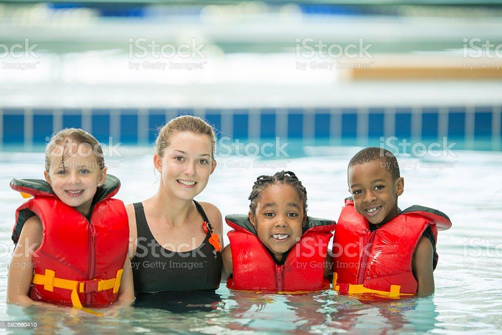 Children with Their Swim Instructor stock photo