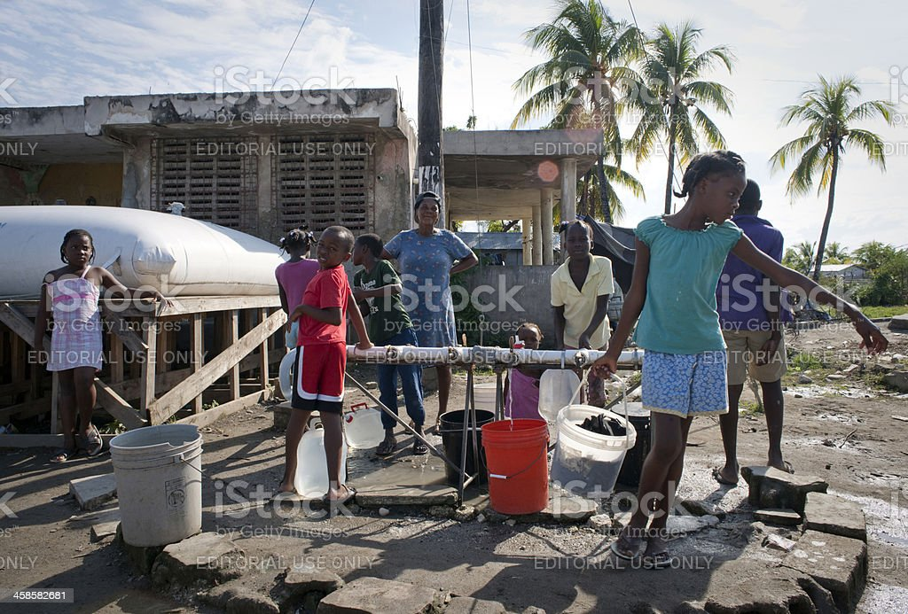 Children with water buckets stock photo