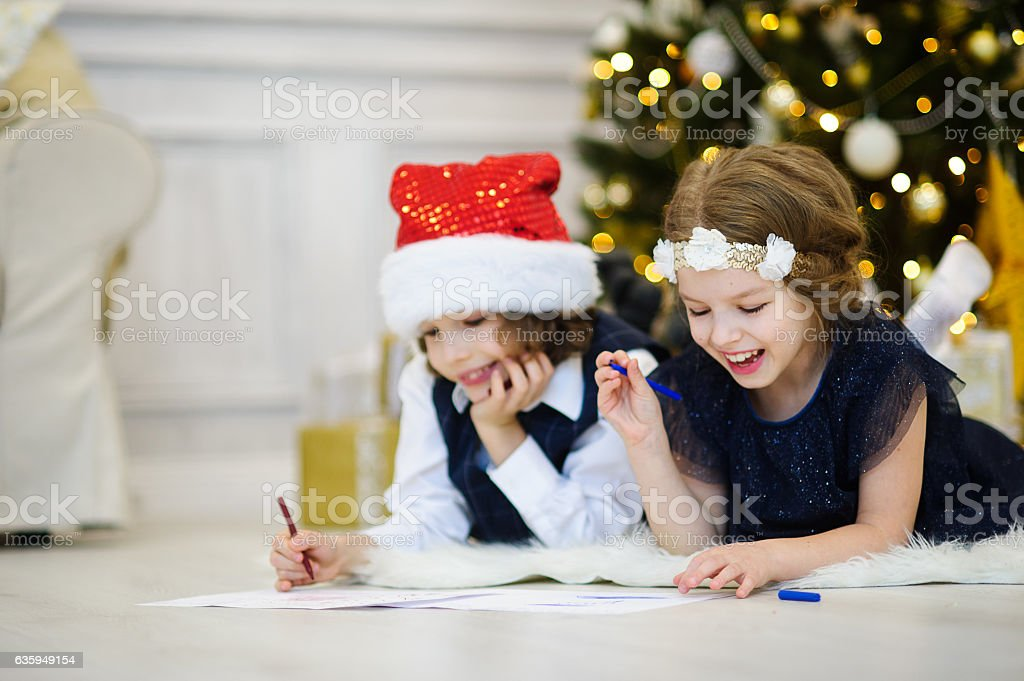 Children write letters to Santa Claus. stock photo