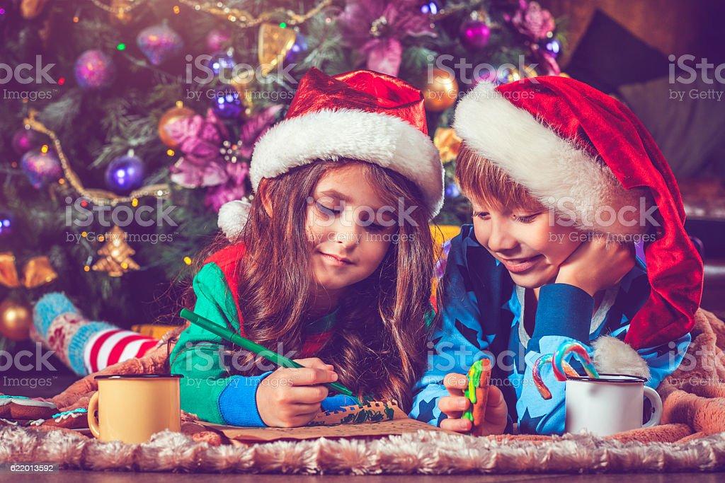 Children writing a letter to Santa stock photo
