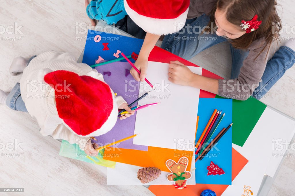 Children writing letter to santa, wait for christmas, top view stock photo
