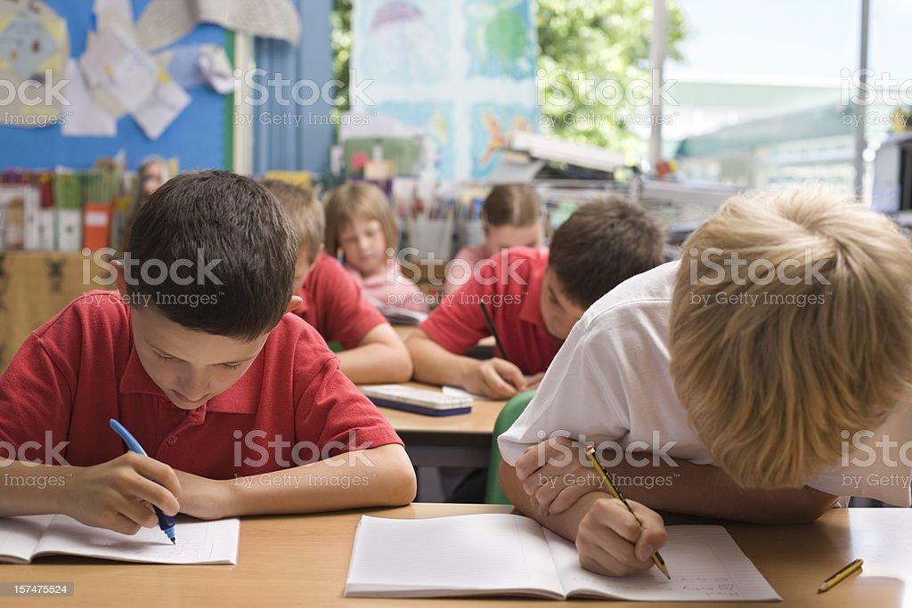 Children writing stock photo