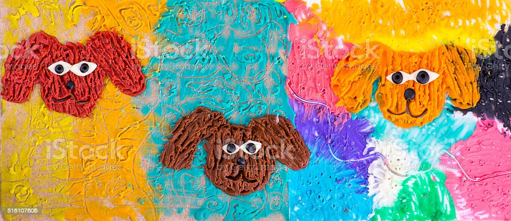 Children's application from plasticine on a cardboard 'dog Three' stock photo