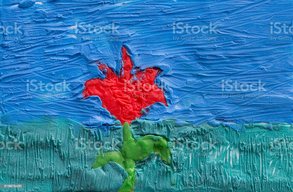 Children's application from plasticine on a cardboard 'Red Flower' stock photo