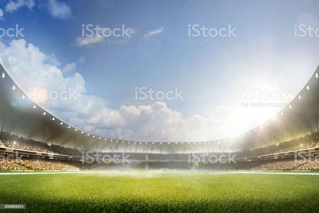 Childrens are playing soccer on grand arena stock photo