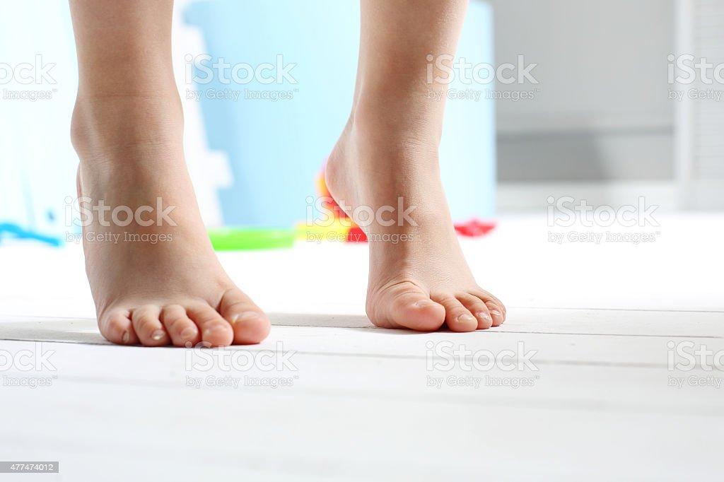 Children's bare feet stock photo