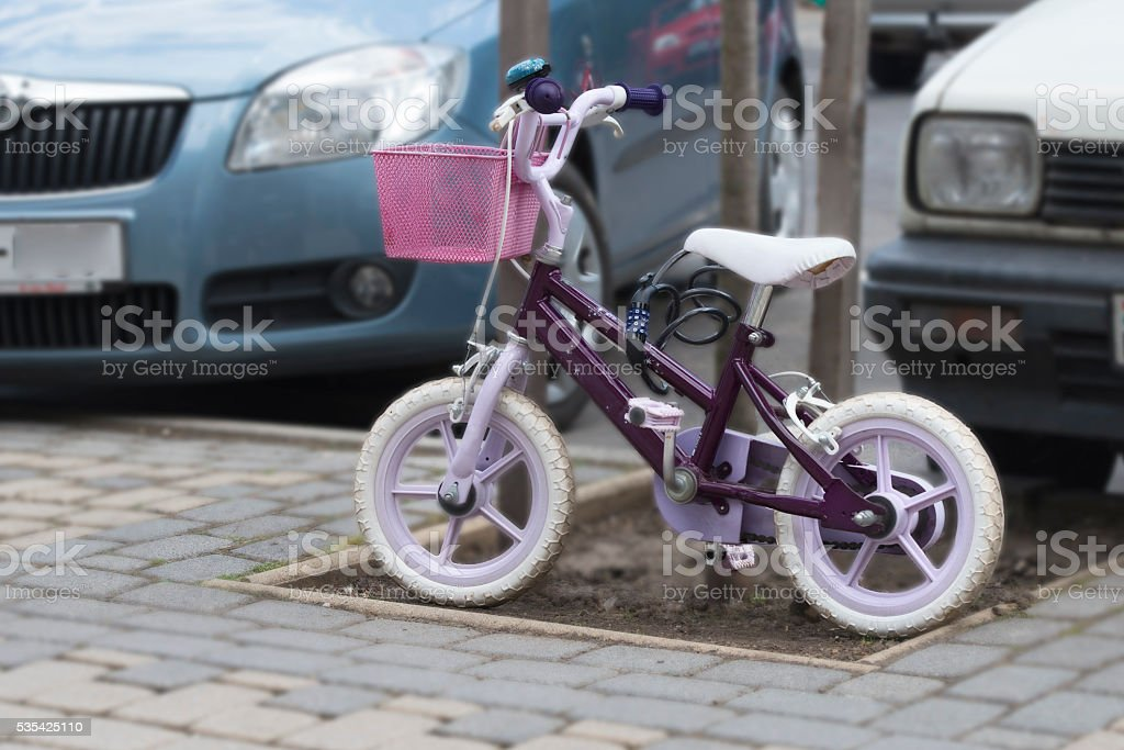 children's Bicycle parked by all the rules stock photo