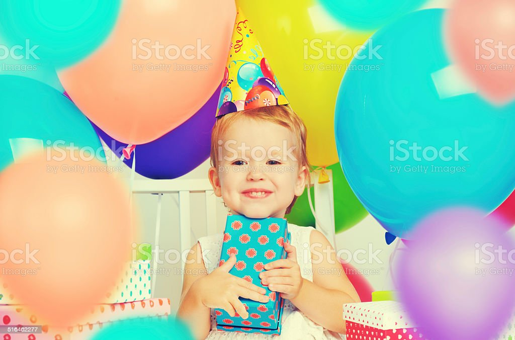 Children's birthday. happy little girl with gifts stock photo