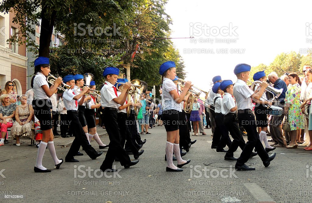 Children's brass band on the city street stock photo
