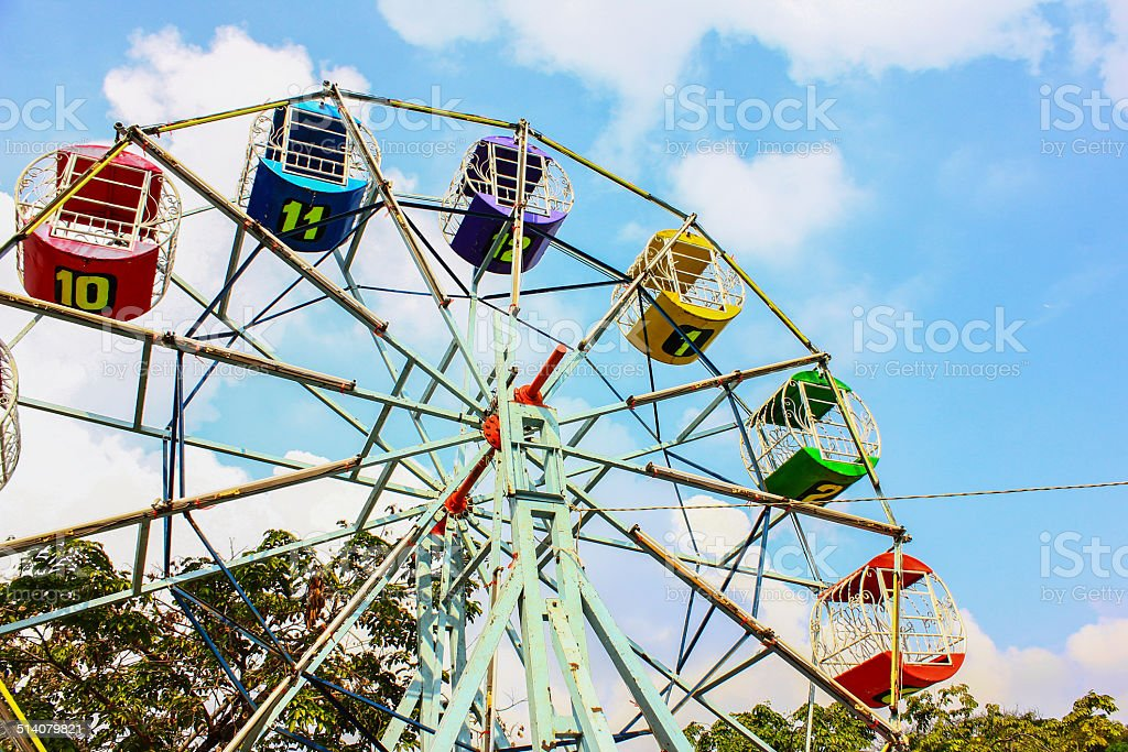 Children's carousel with colored booths stock photo