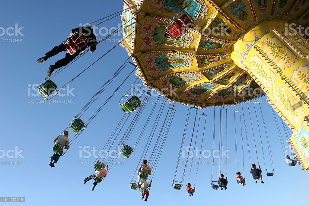 A children's chairs plane in action on a lovely day stock photo