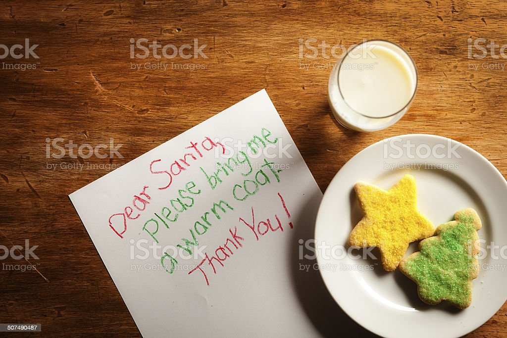 Children's Christmas Letter to Santa Claus with Cookies and Milk stock photo
