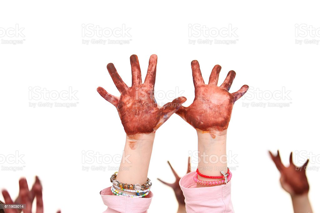Children's colorful hands raised up stock photo