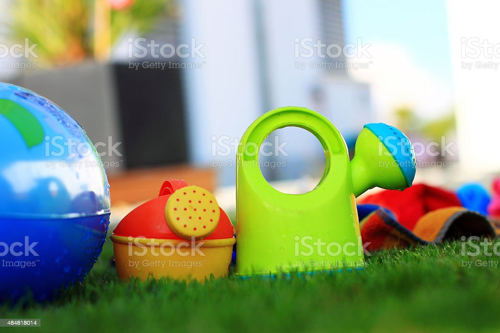 Childrens colorful watering cans stock photo