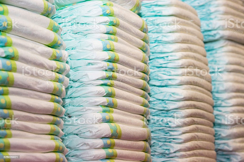 Children's diapers stacked in a piles stock photo