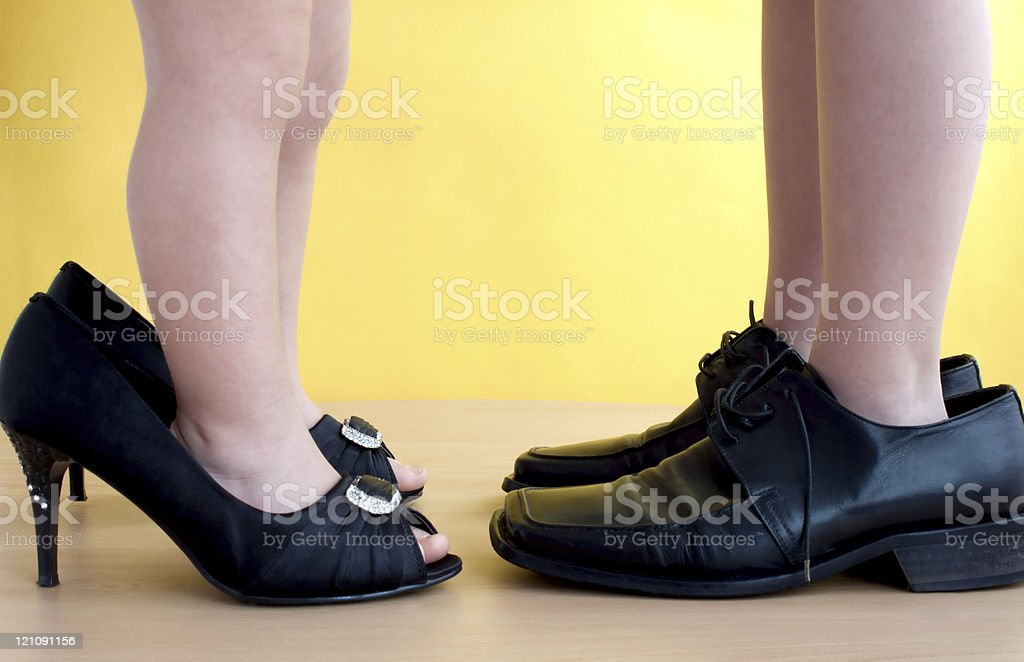 children's feet in the shoes of adults royalty-free stock photo