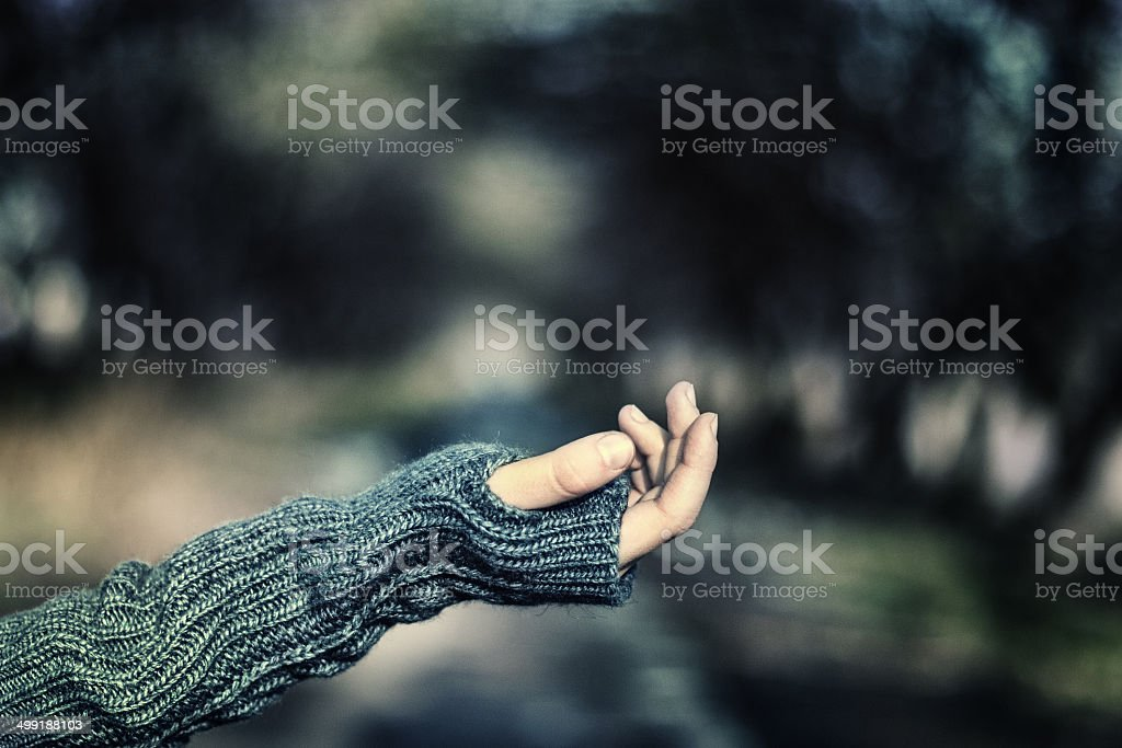 Children's hand asking for alms in the park stock photo