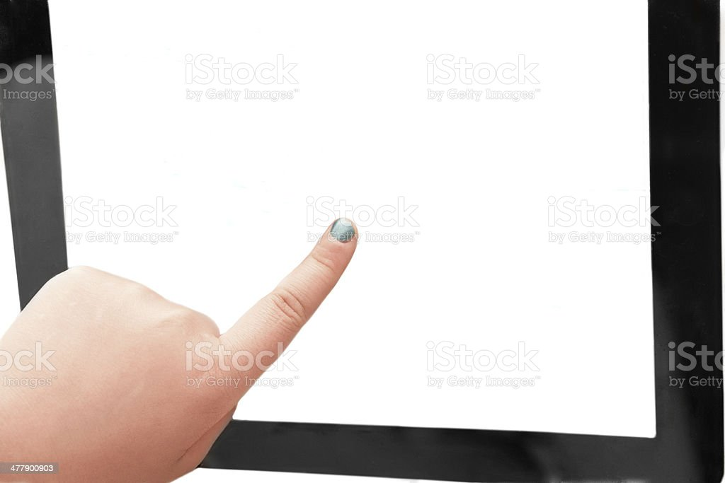 Children's hand rests on the screen black tablet PC royalty-free stock photo