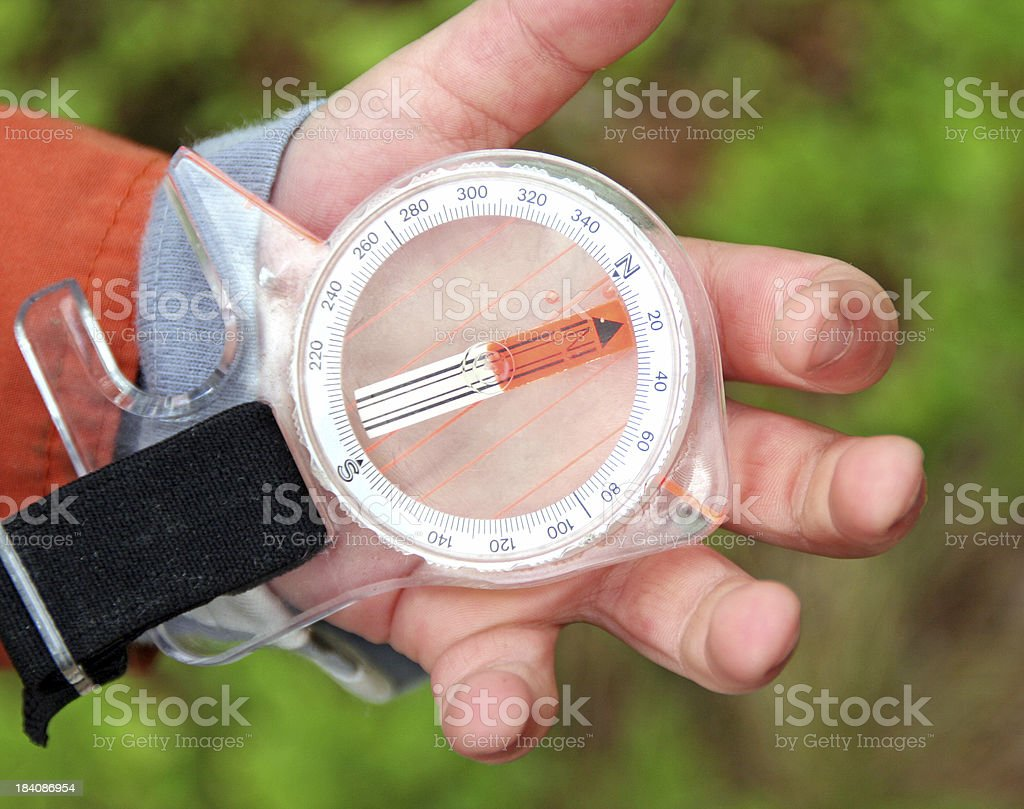 Children's hand with a compass stock photo