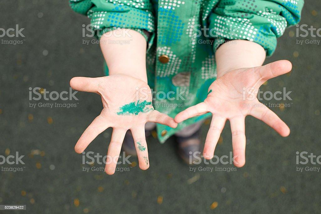 children's hands in wet paint stock photo