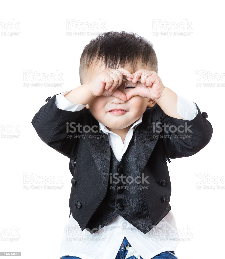Children's hands show signs of heart stock photo