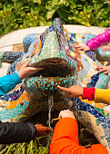 children's hands touching famous statue