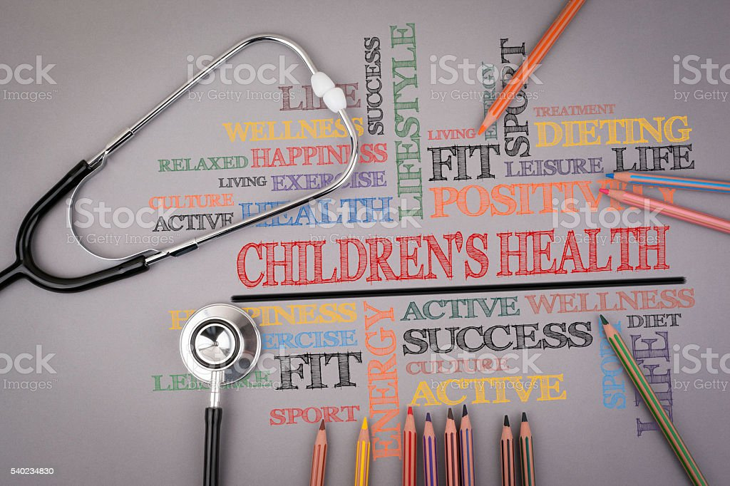 Children's Health. Colored pencils and a stetoscope on the table stock photo