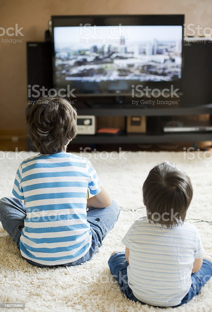 Childrens in front of TV royalty-free stock photo