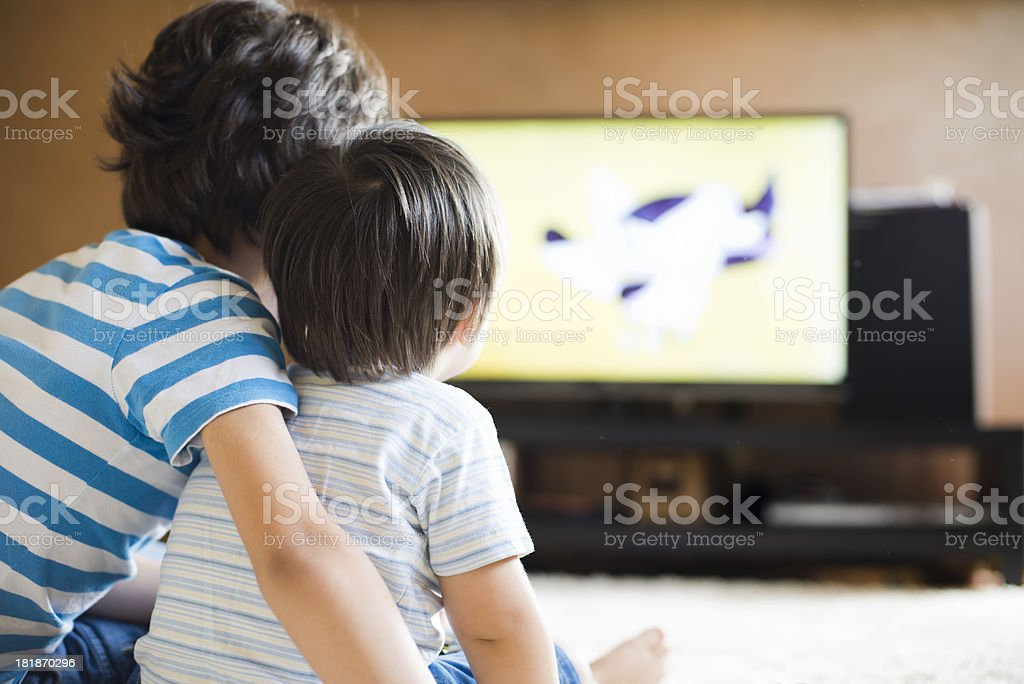 Childrens in front of TV stock photo