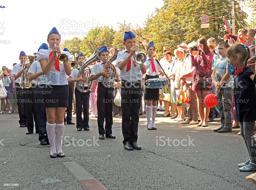 Children's marching band on the city street stock photo
