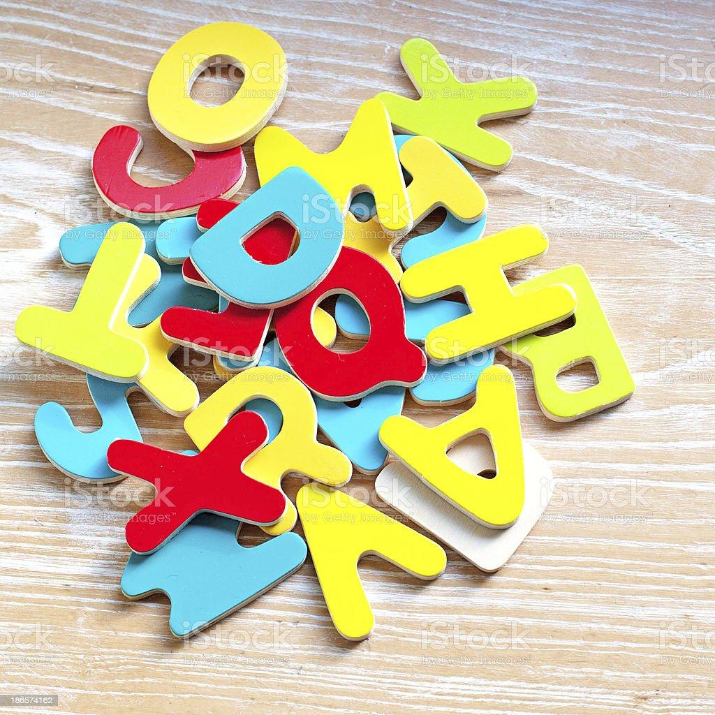 Children's multi coloured wooden alphabets stock photo