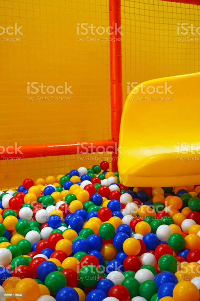 Children's play room with multi-colored hollow balls stock photo