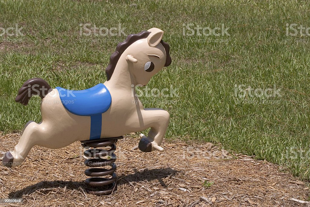 Children's Playground Rocking Horse stock photo