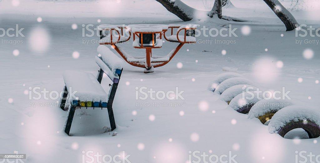 Children's Playground under the snow. Winter in the city stock photo