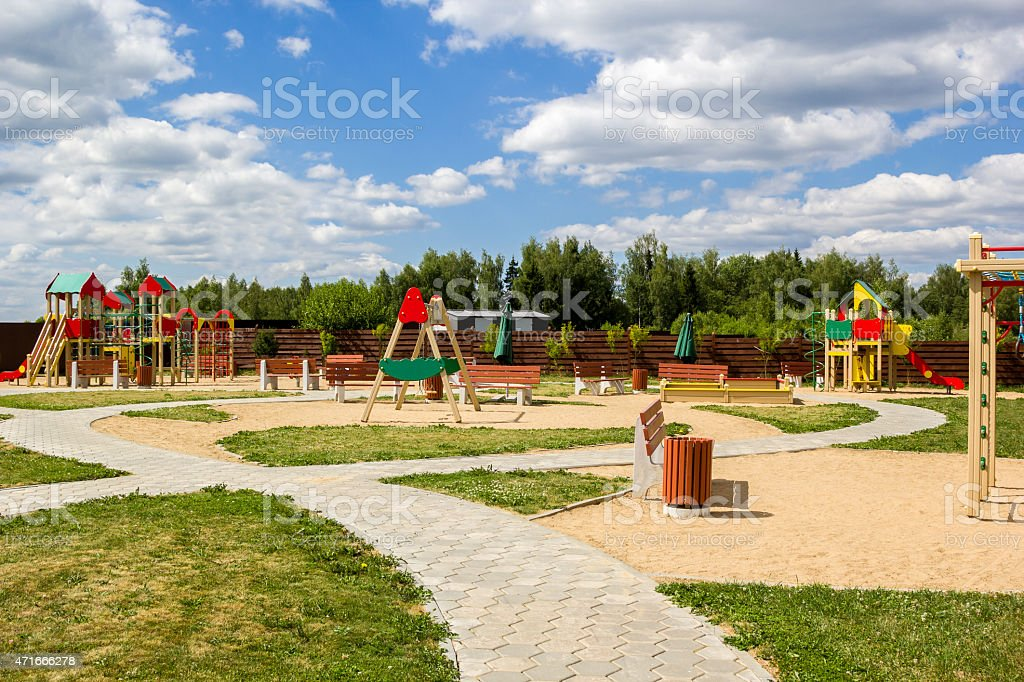 children's playground with swings and slides countryside stock photo