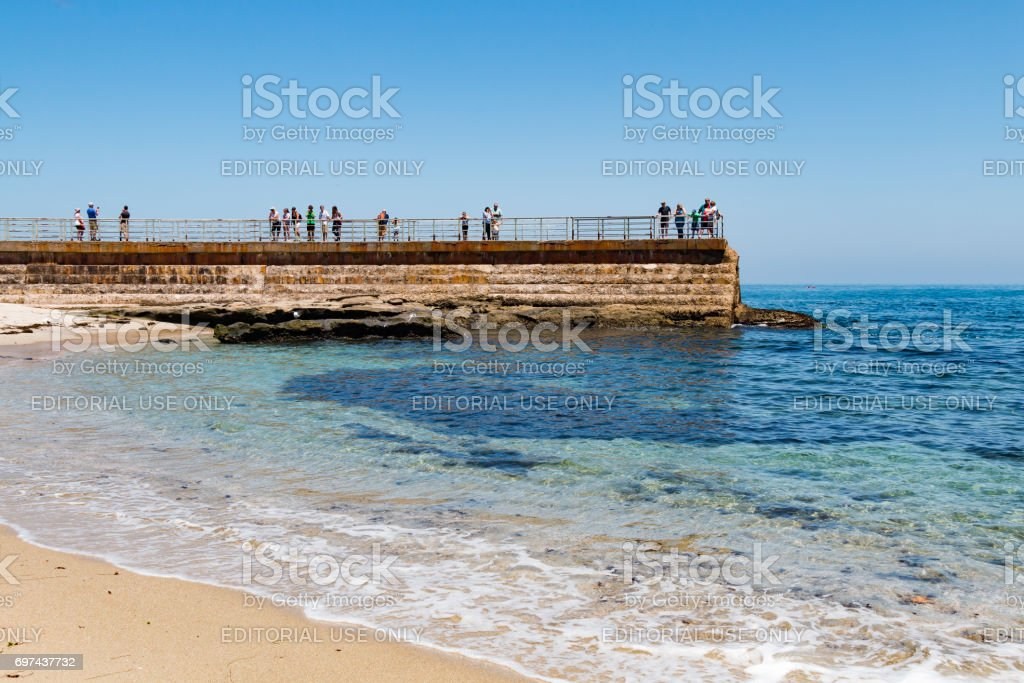 Children's Pool in La Jolla With People on Sea Wall stock photo