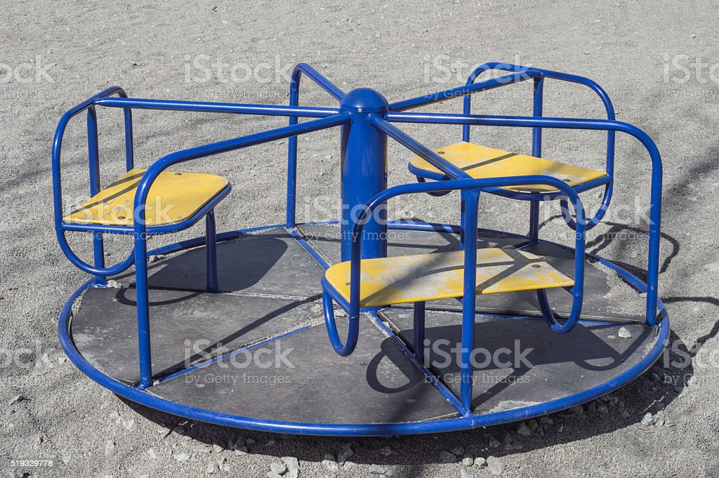 Children's roundabout (merry-go-round) on the playground stock photo