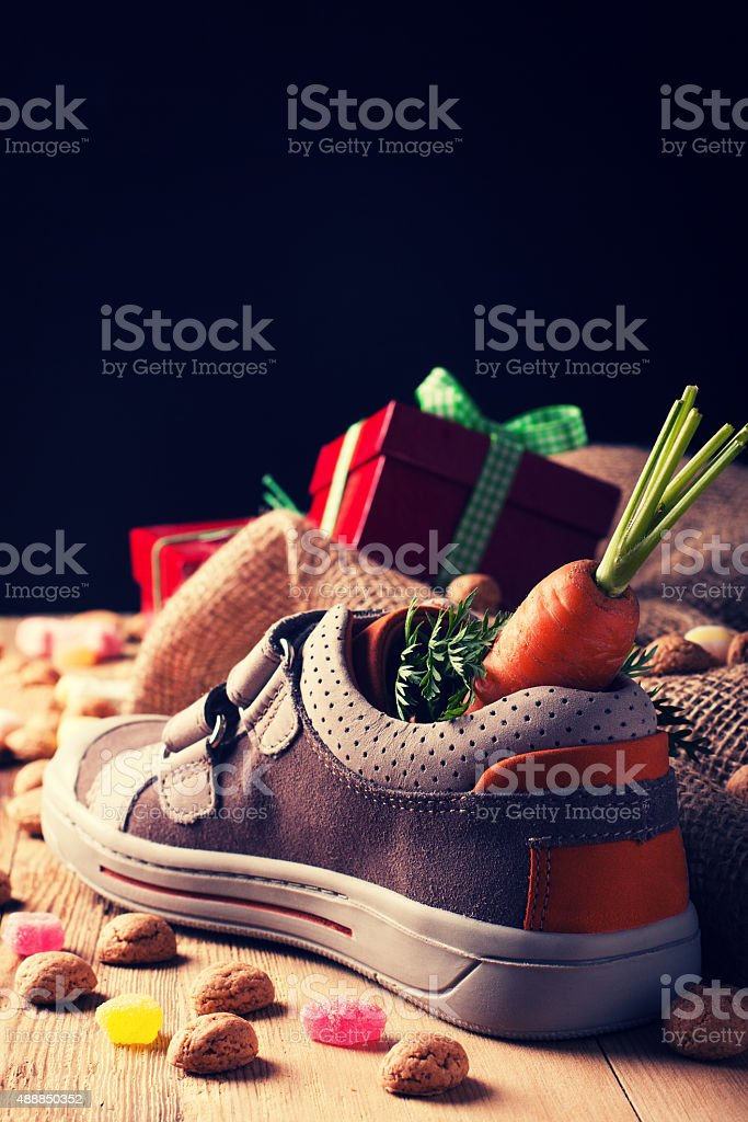 Childrens shoe and pepernoten for Sinterklaas stock photo