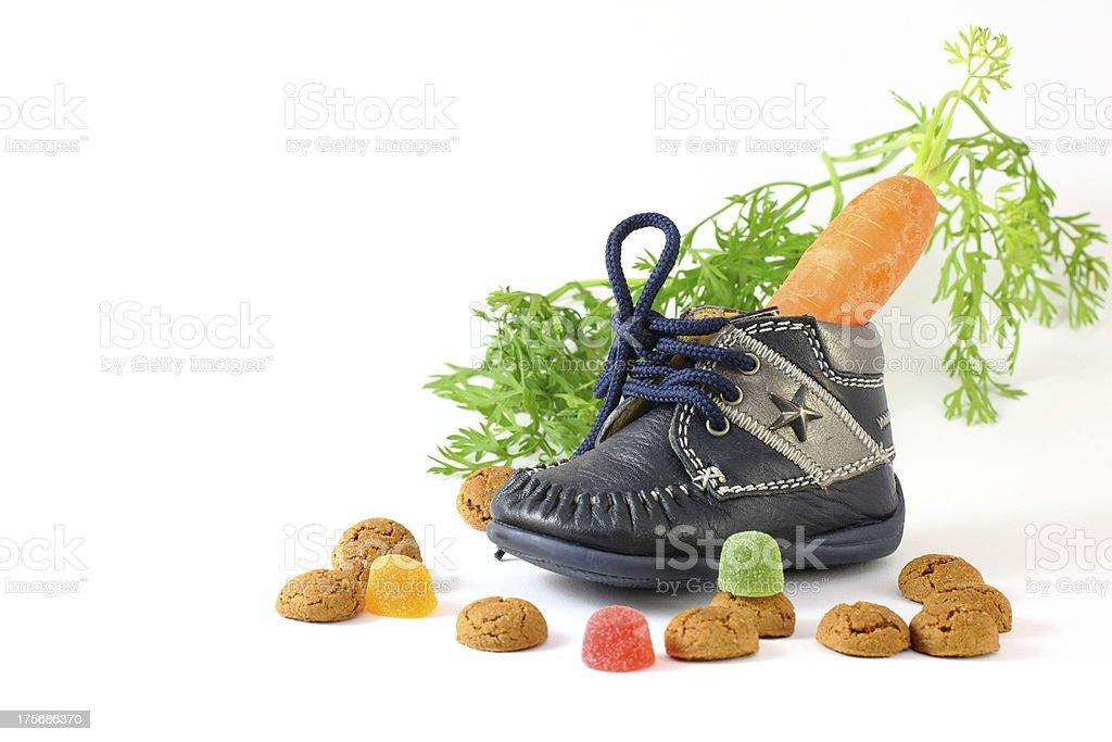 Childrens shoe with carrot voor Sinterklaas and pepernoten royalty-free stock photo