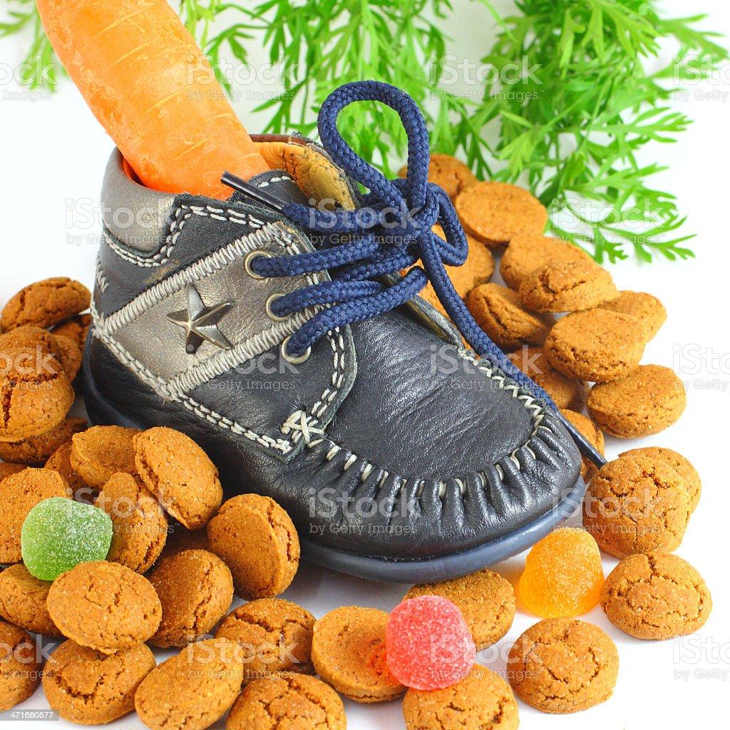 Childrens shoe with carrot voor Sinterklaas and pepernoten stock photo
